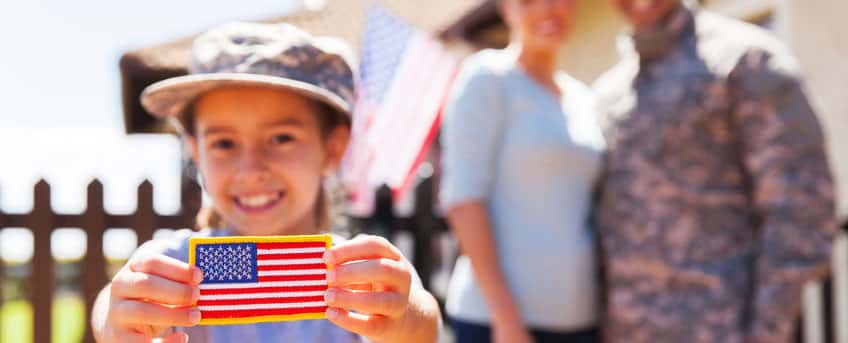 girl holding an america flag