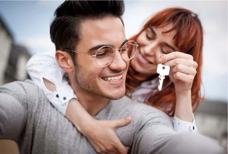 couple holding new set of keys
