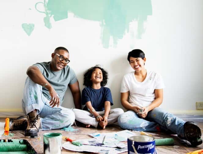 couple and daughter painting home